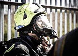 Firefighter wearing helmet